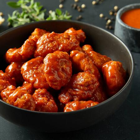 $4 Full Boneless Wings with the purchase of a large pizza at regular price.